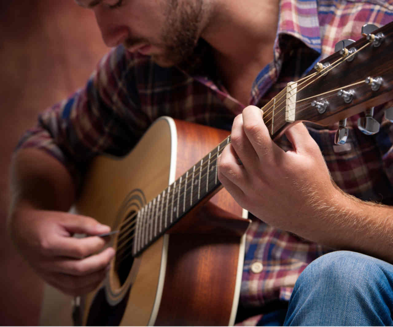 Worship Ministry - young man playing acoustic guitar
