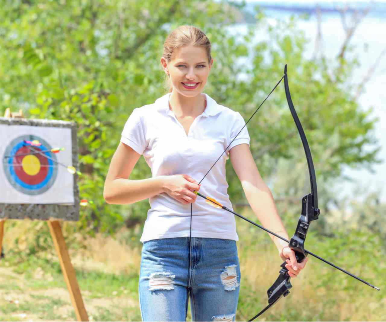 Teenaged girl practices archery