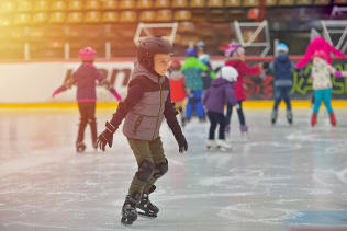 little boy skating at public skating event