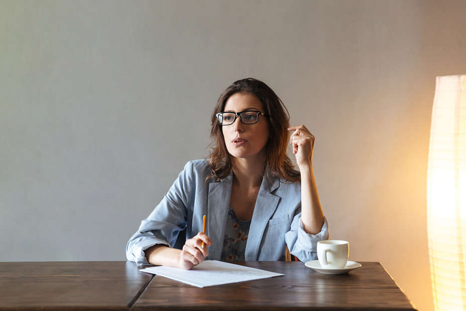 Woman thinking about what to write